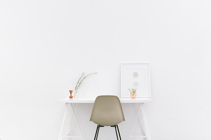 minimalism home office with white picture frame, beige office chair and small plant